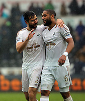 (L-R) Jordi Amat and Ashley Williams of Swansea City are delighted with their win after the Barclays Premier League match between Swansea City and Liverpool at the Liberty Stadium, Swansea on Sunday May 1st 2016