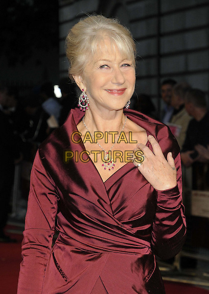 "HELEN MIRREN .""The Debt"" UK premiere, Curzon Mayfair cinema, Curzon St., London, England..September 21st, 2011.half length red maroon burgundy wrap jacket skirt hand on hip black clutch bag necklace rings tattoos.CAP/CAN.©Can Nguyen/Capital Pictures."