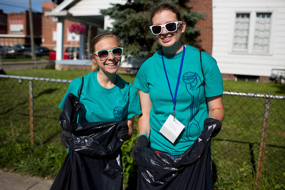 "Sally Finkel, left, and Molly Baumann pose for a photo as they pick up trash in the Hawthorne neighborhood during ""Circle the City with Service,"" the Kiwanis Circle K International's 2015 Large Scale Service Project, on Wednesday, June 24, 2015, in Indianapolis. (Photo by James Brosher)"
