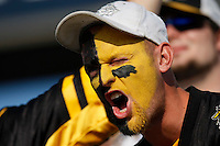 Jul 7, 2007; Hamilton, ON, CAN; A face painted Hamilton Tiger-Cats fan yells prior to the 2007 season home opener against the Toronto Argonauts at Ivor Wynne Stadium. The Argos defeated the Tiger-Cats 30-5. Mandatory Credit: Ron Scheffler, Special to the Spectator.