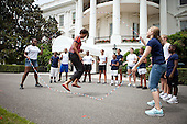 First Lady Michelle Obama and kids double-dutch jump rope during a taping for the Presidential Active Lifestyle Award (PALA) challenge and Nickelodeon's Worldwide Day of Play, on the South Lawn of the White House, July 15, 2011. .Mandatory Credit: Chuck Kennedy - White House via CNP