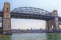 A view under the Burrard Street Bridge of Granville Island