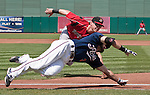Reno Aces Adam Eaton dives past the tag of Albuquerque Isotopes first baseman Jerry Sands and is safe at first during their game played on Sunday afternoon, August 12, 2012 in Reno, Nevada.