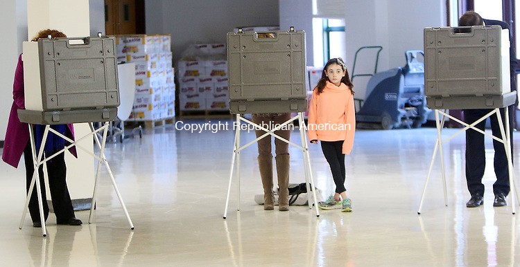 CHESHIRE CT. 08 November 2016-110816SV09-Celeste Elliot, 8, of Cheshire votes with her mom as Rep. Elizabeth H. Esty, D-5th District, left, and Sen. Christopher S. Murphy, D-Conn, right, vote at Cheshire High School in Cheshire Tuesday.<br /> Steven Valenti Republican-American
