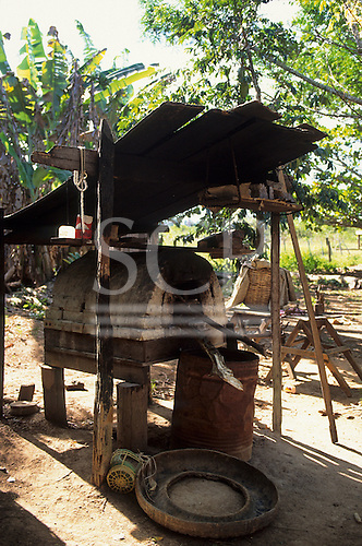 Juruena, Amazon, Brazil. Wood-fired bread oven in a rough outdoor shelter. Mato Grosso State.