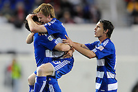Dax McCarty (13) of FC Dallas celebrates scoring with Heath Pearce (4)  and Zach Loyd (19) (R) during a Major League Soccer (MLS) match against the New York Red Bulls at Red Bull Arena in Harrison, NJ, on April 17, 2010.