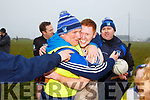 Gerdie O'Sullivan one of the St Mary's Management team celebrates with his son Darragh after their win on Sunday.