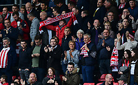Lincoln City fans applaud their team at the final whistle<br /> <br /> Photographer Chris Vaughan/CameraSport<br /> <br /> The EFL Sky Bet League Two - Lincoln City v Chesterfield - Saturday 7th October 2017 - Sincil Bank - Lincoln<br /> <br /> World Copyright &copy; 2017 CameraSport. All rights reserved. 43 Linden Ave. Countesthorpe. Leicester. England. LE8 5PG - Tel: +44 (0) 116 277 4147 - admin@camerasport.com - www.camerasport.com