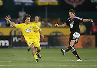 Dejan Jakovic #5 of D.C. United tries to stop a pass from Guillermo Barros Schelotto #7 of the Columbus Crew during a US Open Cup semi final match at RFK Stadium on September 1 2010, in Washington DC. Columbus won 2-1 aet.