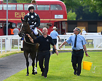 Excellent Sounds ridden by Charlie Bennett are led into the winners enclosure after winning The Cara Glass Fillies' Handicap (Class 5), during Father's Day Racing at Salisbury Racecourse on 18th June 2017