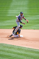 Yadiel Rivera (4) of the Colorado Springs Sky Sox starts the double play against the Salt Lake Bees in Pacific Coast League action at Smith's Ballpark on May 24, 2015 in Salt Lake City, Utah.  (Stephen Smith/Four Seam Images)