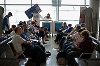 People wait for flights in Terminal D of Sheremetyevo International Airport in Khimki, Moscow, Moskovskii Oblast, Russia. The airport is one of the main entries to Russia.