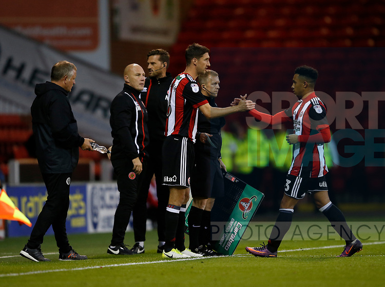 Chris Basham of Sheffield Utd replaces Jake Bennett of Sheffield Utd during the Carabao Cup First Round match at Bramall Lane Stadium, Sheffield. Picture date: August 9th 2017. Pic credit should read: Simon Bellis/Sportimage