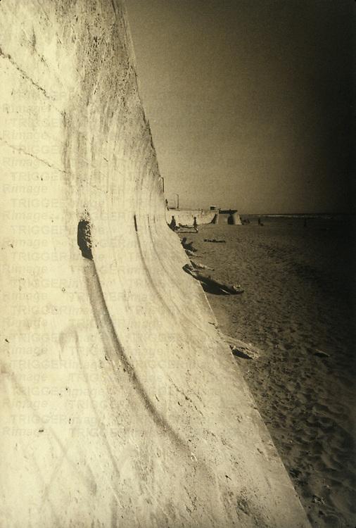 figure on seawall at Ocean Beach, San Francisco, California