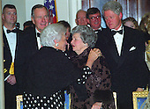Former first lady Barbara Bush and former first lady Lady Bird Johnson speak to one another in the Grand Foyer of the White House at the 200th Anniversary of the White House Dinner in Washington, D.C. on November 9, 2000.  Looking on are former U.S. President George H.W. Bush and U.S. President Bill Clinton.<br /> Credit: Ron Sachs / CNP