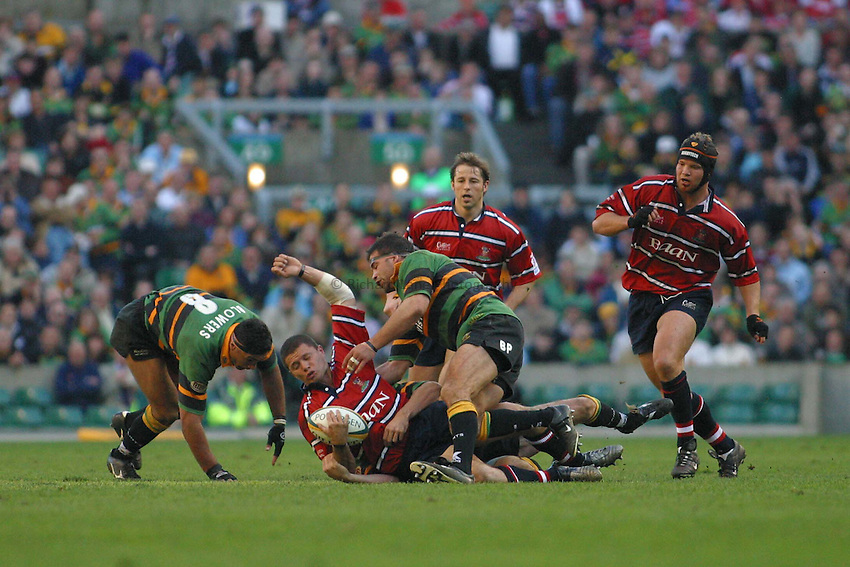 Photo. Jo Caird.Gloucester v Northampton Saints. Powergen Cup Final. 05/04/2003.Henry Paul is tackled.