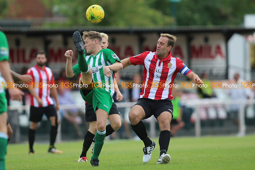 Lewis Clayton of Soham clears from Elliot Styles of Hornchurch during AFC Hornchurch vs Soham Town Rangers, Bostik League Division 1 North Football at Hornchurch Stadium on 12th August 2017