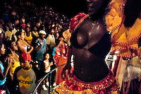 A sweaty Cuban girl performs a dancing show during the Carnival in Santiago de Cuba, Cuba, 25 July 2008. Carnival in Santiago de Cuba is a large public celebration which is held - contrary to the other Latin American carnivals - in the summer. The carnival tradition dates back to the 17th century when the Spanish festival of Santiago (St. James) was mixed with street dancing parades of the Black African slaves. Nowadays comparsas, carnival groups of dancers and musicians, flow in the streets and perform popular music like salsa, rumba or reggaeton. In spite of the general lack of funds in Cuba (most of the festival costumes and floats are home-made) the Carnival is very lively and hot show with huge participation of the people of Santiago de Cuba.