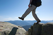 Appalachian Trail - A hiker on the summit of Mount Lincoln heading north on the Franconia Ridge Trail during the spring months. Located in the White Mountains, New Hampshire USA