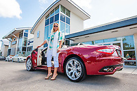 Sandra Kaseta with a Maserati for sale at Luxury Imports of Naples, 900 Tamiami Trail, Naples, Florida, USA, July 20, 2012. Photo by Debi Pittman Wilkey, CoastalLife.com.