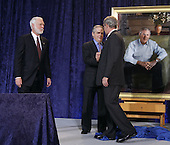 Washington, DC - December 19, 2008 -- United States President George W. Bush, right, shakes hands with artist Robert Anderson while G. Wayne Clough, Secretary of Smithsonian looks on from the left after the unveiling of his portrait at the National Portrait Gallery in Washington, D.C. on Friday, December 19, 2008. .Credit: Ken Cedeno / Pool via CNP