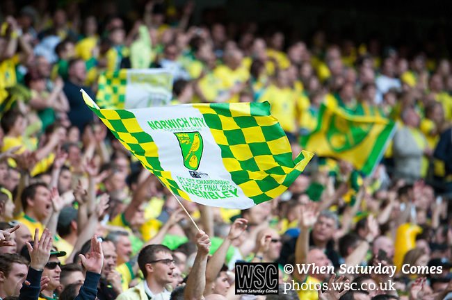 Norwich City 2 Middlesbrough 0, 25/05/2015. Wembley Stadium, Championship Play Off Final. A Norwich flag is waved during the match worth £120m to the victors. On the day Norwich City secured an instant return to the Premier League with victory over Middlesbrough in front of 85,656. Photo by Simon Gill.