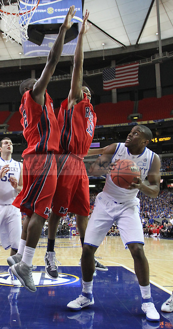 ATLANTA, GA. - Darius Miller is guarded by Steadman Short and Zach Graham in the second round of the SEC Tournament between Kentucky and Ole Miss , played at the Georgia Dome, Friday, March 11, 2011.  Photo by Latara Appleby | Staff