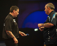 04.01.2015.  London, England.  William Hill PDC World Darts Championship.  Finals Night.  Gary Anderson (4) [SCO] and Phil Taylor (2) [ENG] during their match.  Gary Anderson won the match 7-6