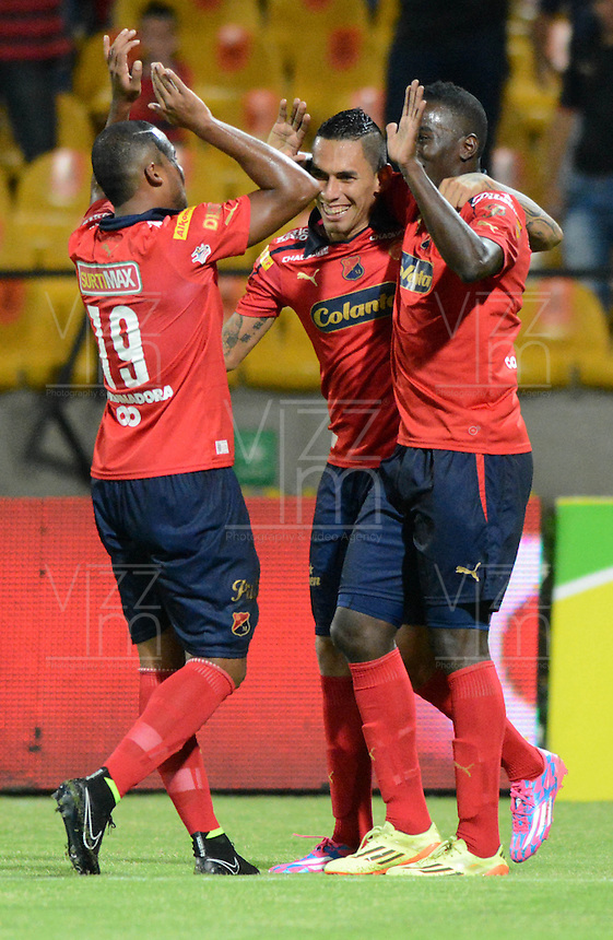 MEDELLIN - COLOMBIA -17-08-2014:  Los jugadores de Deportivo Independiente Medellin celebran el gol anotado al Atletico Huila durante partido Deportivo Independiente Medellin  y Atletico Huila de la fecha  5 de la Liga Postobon II 2014, jugado en el estadio Atanasio Girardot de la ciudad de Medellin. / The players of Deportivo Independiente Medellin celebrate a goal scored to Atletico Huila during a match Deportivo Independiente Medellin and Atletico Huila for the date 5 th of the Liga Postobon II 2014 at the Atanasio Girardot stadium in Medellin city. Photo: VizzorImage  / Luis Rios / Str.