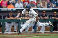 Michigan Wolverines designated hitter Jordan Nwogu (42) begins to slide at home during Game 1 of the NCAA College World Series against the Texas Tech Red Raiders on June 15, 2019 at TD Ameritrade Park in Omaha, Nebraska. Michigan defeated Texas Tech 5-3. (Andrew Woolley/Four Seam Images)