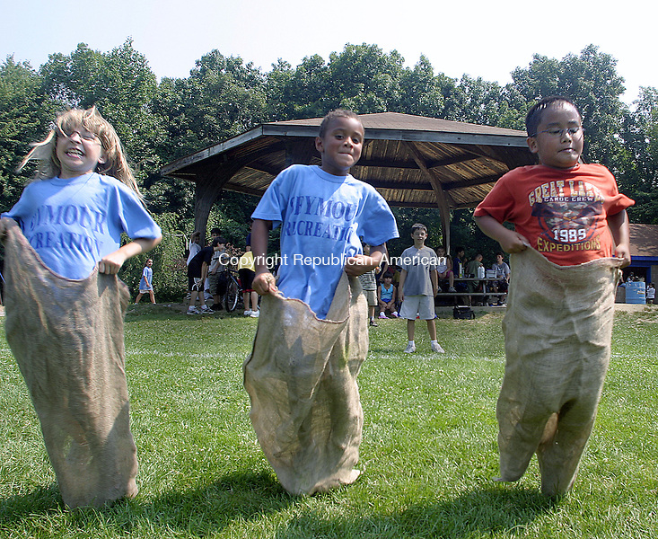 SEYMOUR, CT -03 AUGUST 2007 - -080307DA02-  It was a close potato sack race between Sarah Lavranchuk, 8, left, Trent Nayve, 8, center, and Jared Valdes, 7, right, during a field day competition organized by two Seymour Park and Recreation Department Playground Camps Friday at Gary Park in Seymour. Campers from the Chatfield Park joined the kids at Gary Park for outdoor activities that included bombardment and the three legged race.<br /> Darlene Douty/Republican-American