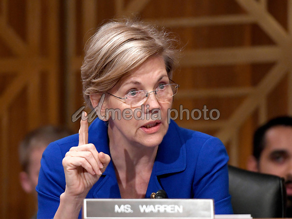 """United States Senator Elizabeth Warren (Democrat of Massachusetts) questions Richard F. Smith, former Chairman and Chief Executive Officer, Equifax, Inc. as he gives testimony before the United States Senate Committee on Banking, Housing, and Urban Affairs as they conduct a hearing entitled, """"An Examination of the Equifax Cybersecurity Breach"""" on Capitol Hill in Washington, DC on Tuesday, October 3, 2017. Photo Credit: Ron Sachs/CNP/AdMedia"""