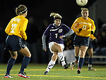 SIOUX FALLS, SD - NOVEMBER 1:  Caitlin Crouse #7 from the University of Sioux Falls passes the ball between Stephanie Stevens #17 and Taylor Brownrigg #11 from Augustana in the first half of their game Friday night at the USF Sports Complex. (Photo by Dave Eggen/Inertia)