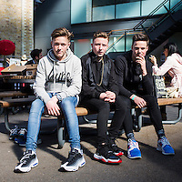 L-R: Ralph wears Nike Air Max 95, JJ wears Air Jordan XI Breds, Billy wears Nike Air Flow. The three boys travelled from Essex and bought V.I.P. tickets to Crepe City, London's biggest trainer event. They are seen wearing the shoes that they purchased.<br /> Spitalfields, London, 2014.