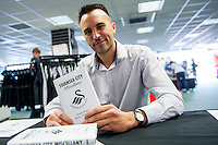 Author Chris Carra signs his new book on the Swansea Club Sohop ahead of the  Premier League match between Swansea City and Everton played at the Liberty Stadium, Swansea  on September 19th 2015