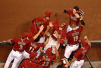 Sept 9, 2007; Phoenix, AZ, USA; Arizona Diamondbacks left fielder (22) Eric Byrnes and shortstop (6) Stephen Drew are congratulated by their teammates after scoring in the seventh inning against the St. Louis Cardinals at Chase Field. Mandatory Credit: Mark J. Rebilas-US PRESSWIRE