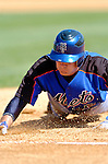 18 March 2006: Jeff Keppinger, infielder for the New York Mets, dives safely back to first during a Spring Training game against the Washington Nationals at Space Coast Stadium, in Viera, Florida. The Nationals defeated the Mets 10-2 in Grapefruit League play...Mandatory Photo Credit: Ed Wolfstein Photo..