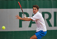 France, Paris, 26.05.2014. Tennis, Roland Garros, Robin Haase (NED) in action in his match against  Nicolay Davydenko (RUS) <br /> Photo:Tennisimages/Henk Koster