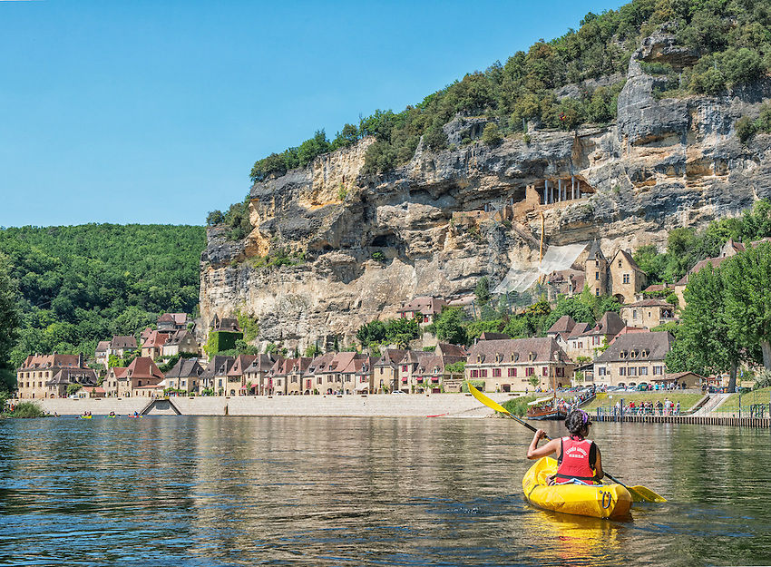 Approaching La Roque-Gageac by kayak on the Dordogne. Kayaks and canoes are available for rent at many locations along the Dordogne. The river has a steady current that makes it easy to drift down river with a minimum of paddling.