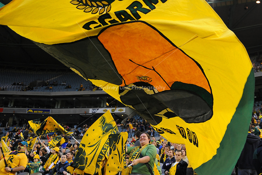 MELBOURNE, AUSTRALIA - OCTOBER 14: Australian supporters wave their flags in a AFC Asian Cup 2011 match between Australia and Oman at Etihad Stadium on October 14, 2009 in Melbourne, Australia. Photo Sydney Low www.syd-low.com