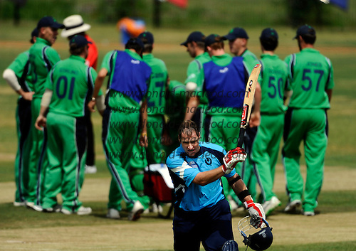 ICC World Cricket League, Div 1 - Scotland V Ireland at the Voorburg Cricket Club, Netherlands - Scotland's Neil McCallum departs after a stoic 49 run knock as eventual match-winners Ireland celebrate - Picture by Donald MacLeod 05.07.10 - mobile 07702 319 738 - clanmacleod@btinternet.com