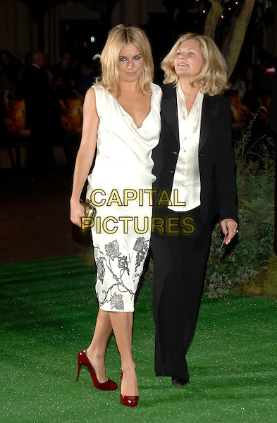 "SIENNA MILLER & JO MILLER (MOTHER).""Stardust"" European film premiere.Odeon, Leicester Square.3rd October 2007 London, England.full length profile sleeveless white dress silver pattern print maroon shoes red cowel neck gold clutch purse bag black trousers jacket cream blouse mom mum daughter family .CAP/PL.©Phil Loftus/Capital Pictures"