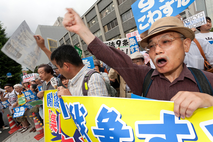Older people at a protest against the revision of article 9 of the Japanese Constitution outside the Prime-Minister's house in Kasumigasaki, Tokyo, Japan. Monday June 30th 2014. Over 10,000 people showed their support for Japan's unique peace constitution and called on the government to halt its reinterpretation of Article 9 allowing Collect Self Defence which is expected to become law on July 1st