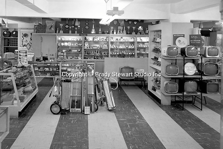 Client: Eiben and Irr Company<br /> Ad Agency:  Eiben and Irr Marketing<br /> Products: Department Store items<br /> Location: Wood Street and Liberty Avenue in Pittsburgh<br /> <br /> Location photography for Eiben and Irr's Holiday Catalog.  New Wilson Golf clubs and RCA Color Televisions for sale at Eiben and Irr Department Store.  Eiben and Irr Jewelry and Department Store operated in downtown Pittsburgh at the corner of Wood Street and Liberty Avenue from 1953-1979.