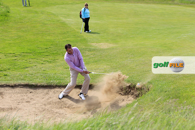 John McGinn (Laytown &amp; Bettystown) in a bunker on the 9th during Round 4 of the Irish Amateur Close Championship at Seapoint Golf Club on Monday 9th June 2014.<br /> Picture:  Thos Caffrey / www.golffile.ie