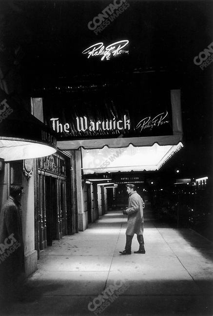 Elvis Presley enter the Warwick Hotel, New York City, March 17, 1956