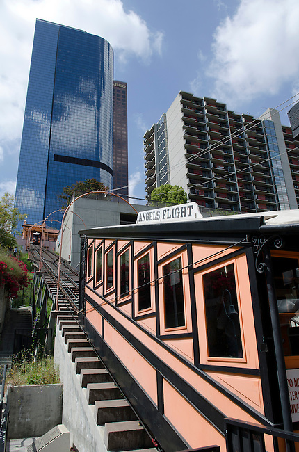 The historic orange and black rail car of Angels Flight, originally opened in 1901, takes passengers at its new location since 2010, from Hill Street up the steep incline of Bunker Hill.  Photo taken April 2011.