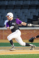 Josh Spano (21) of the High Point Panthers follows through on his swing against the Wake Forest Demon Deacons at Wake Forest Baseball Park on April 2, 2014 in Winston-Salem, North Carolina.  The Demon Deacons defeated the Panthers 10-6.  (Brian Westerholt/Four Seam Images)