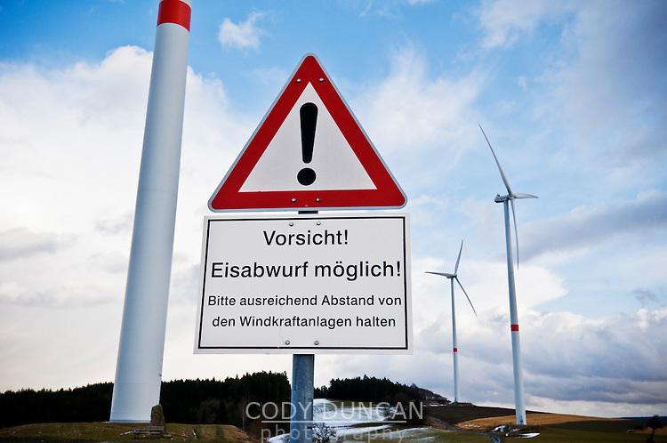 German language warning sign below wind turbine warning of ice fall, Bavaria, Germany