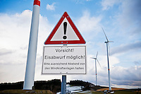 German language warning sign below wind turbine warning of ice fall, Bavaria, Germany